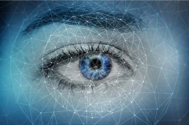 Iris scan image by Sdecoret (via Shutterstock).